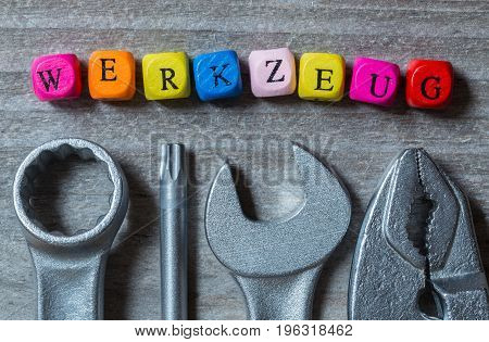 Werkzeug (in German Tool) Letter Cube And Tool On Gray Wood Visualization