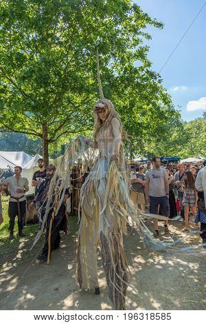 Useldange, Luxembourg, July 6, 2017- Medieval Fair Festival. Beautiful fairy witch with her wooden legs and unicorn horn