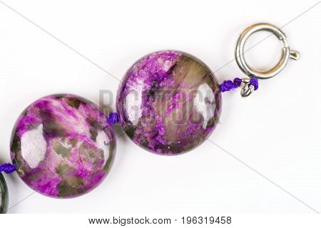 The Violet bracelet beads. The Semiprecious stones of Siberia. Charoit. White background. Isolated.