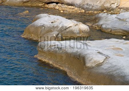 Sea and Rocks bathed in afternoon light at a beach in Kyrenia area Cyprus