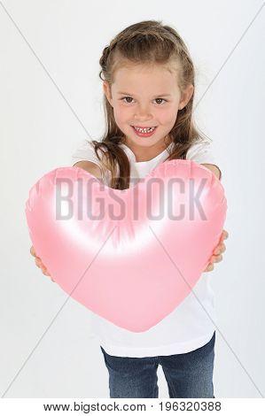 Cute little girl holding heart white background