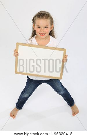 Cute little girl bare feet and with a bare panel smiling