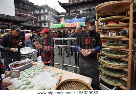 SHANGHAI CHINA - MARCH 19: Unidentified Chinese people trades traditional food on March 19 2016 in Shanghai China. Shanghai is the largest Chinese city by population.