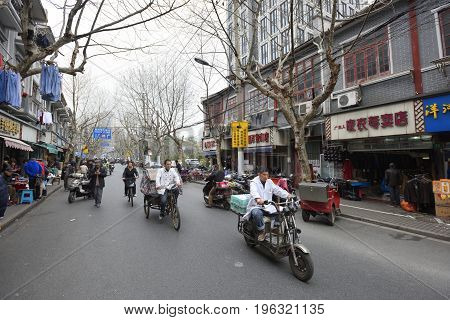 SHANGHAI CHINA - MARCH 19: Shanghai street on March 19 2016 in Shanghai China. Shanghai is the largest Chinese city by population.
