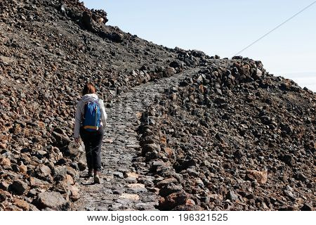 Beautiful view of the girl hiking to the Teide volcano