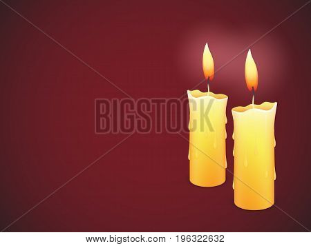 Two burning candles on dark red background
