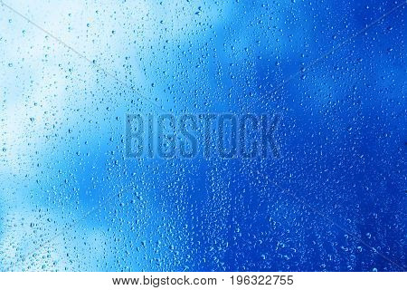 Horizontal blue window glass with water drops background hd