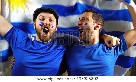 Uruguaian Friends Celebrating with Urugay Flag