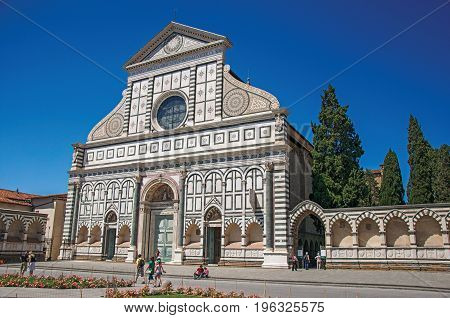 Florence, Italy - May 14, 2013. View of the facade in many types of marbles from the Santa Maria Novella church in the city of Florence, the famous capital of the Italian Renaissance. Tuscany region