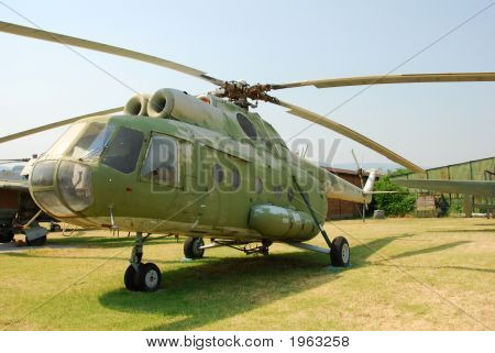 Old military helicopter Mi-8 on the ground poster