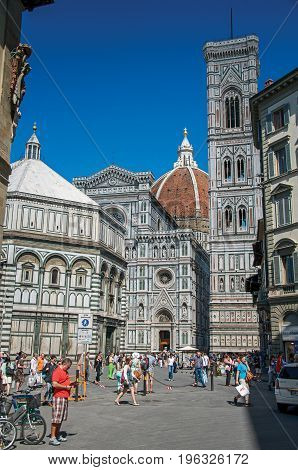 Florence, Italy - May 14, 2013. View of square with the Cathedral Santa Maria del Fiore and Giotto's Campanile (bell tower). In Florence, the famous capital of the Italian Renaissance. Tuscany region