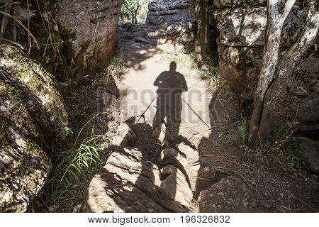 Trekker shadow walking by Torcal Natural Park trails Malaga Spain