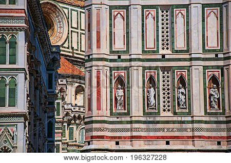 View of detail carved in marble from the Cathedral Santa Maria del Fiore and Giotto's Campanile (bell tower). In Florence, the famous and amazing capital of the Italian Renaissance. Tuscany region