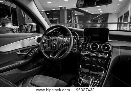 BERLIN - JANUARY 24 2015: Showroom. Cabin of a compact executive car Mercedes-Benz C220 BT Limousine. Black and white. Produced since 2014.