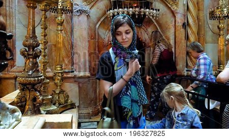 Jerusalem, Israel - May 25, 2017: People are entering into Jesus Empty tomb in Jerusalem in the Holy Sepulcher Church. The Church and Empty Tomb the most sacred places for all Christians in the world.