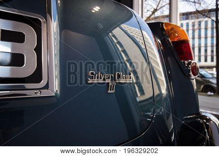 BERLIN - MARCH 08 2015: Showroom. Emblem of a Rolls-Royce Silver Cloud III. Rolls-Royce Motor Cars Limited global manufacturer of luxury cars.