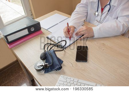 Doctor Writing application form just hands at the table. Medical and Health care concept