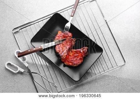 Composition with delicious pork ribs on table