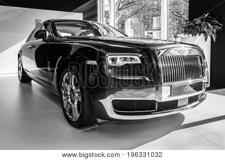 BERLIN - MARCH 08 2015: Showroom. Full-size luxury car Rolls-Royce Ghost. Black and white. Rolls-Royce Motor Cars Limited global manufacturer of luxury cars.