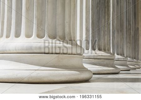Colonnade of Ionic order columns, close up.