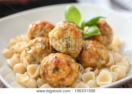 Bowl with turkey meatballs and pasta, closeup