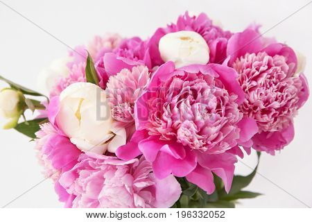 Beautiful bouquet with fragrant peonies on light background