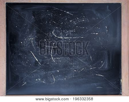 Vintage slate chalk board on wooden background