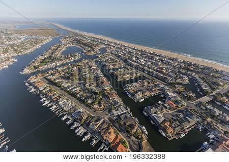 Aerial of Sunset Beach waterfront homes and boats in Orange County California.