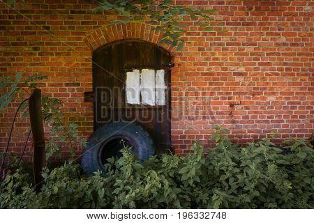 Wooden door in the brick wall