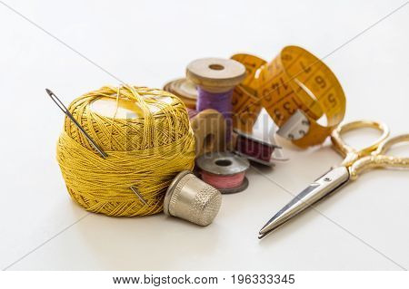 Creative image of sewing accessories for needlework and sewing hobby on white background