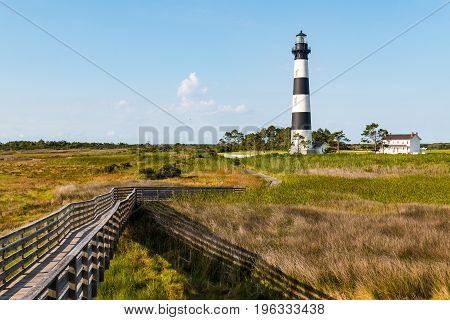 Wooden ramp over marshland, with a boardwalk trail to the Bodie Island lighthouse on the Outer Banks of North Carolina near Nags Head.