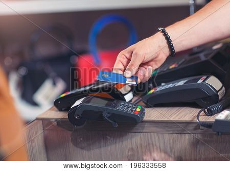 Hand Push Credit Card Into A Credit Card Machine