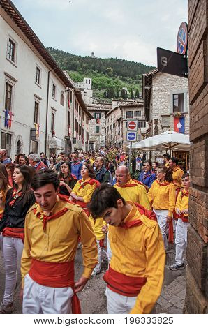 Gubbio, Italy - May 15, 2013. Colorful crowd participating in the