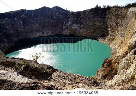 High Panoramic View Of The Green Turquoise Colored Lake In The Kelimutu Volcano During The Morning A