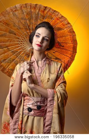 Beautiful Woman In Traditional Japanese Kimono.