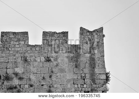 big old wall of ancient stone fortress for a background monochrome tone
