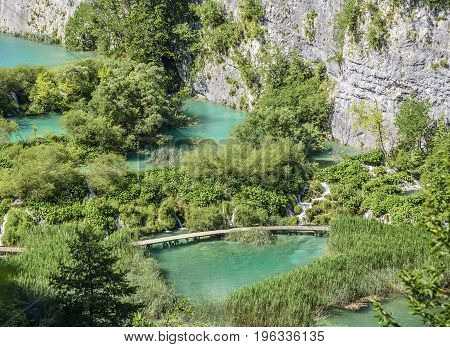 Lakes with blue water in the middle of a mountain landscape. National Park Plitvice Lakes. Croatia.