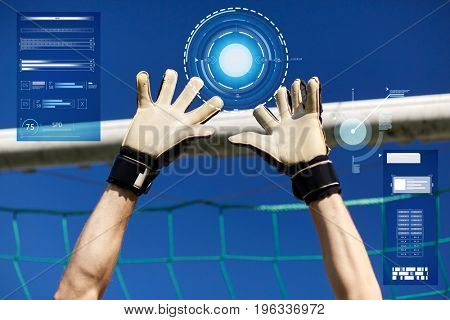 sport and technology concept - soccer player or goalkeeper hands at football goal