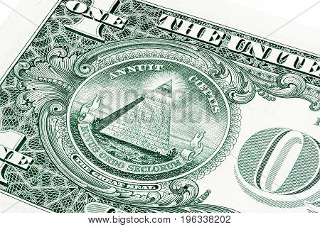 U.S. one 1 dollar bill in a close-up photo. Shallow depth of field effect. Eye of Providence, all-seeing eye of God, Mason Illuminati Logo, Pyramid, Triangle. Great Seal.