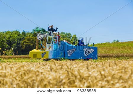 Saint-Quentin-Fallavier France - July 16 2016: Cornetto vehicle during the passing of Publicity Caravan in a wheat plain in the stage 14 of Tour de France 2016.