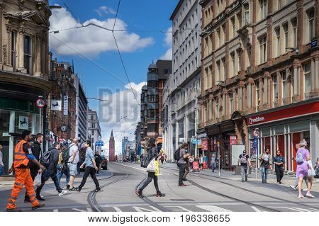 Birmingham, Corporation St, England- JULY 20, 2017:  the main shopping street in the city centre, England. It runs from the law courts at its northern end to the centre of New Street at its southern