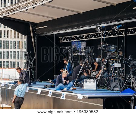 STRASBOURG FRANCE - JUN 30 2017: Journalists and TV crew preparing their camera and broadcasting equipment in dedicated press media area for an official event at the European parliament
