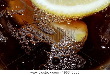cold ice tea with bubbles and lemons