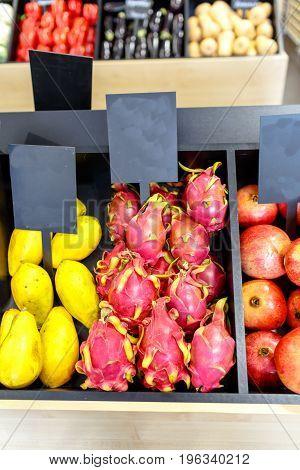 Pitahaya And Papaya On The Shelves In The Supermarket