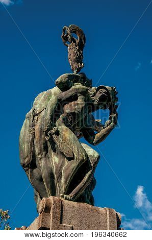 Close-up of bronze sculpture with blue and sunny sky. In a square at the Orvieto city center, an ancient, pleasant and well preserved medieval town. Located in Umbria, central Italy