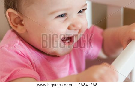 Newborn Baby Girl Smiling With Two Lower Teeth.