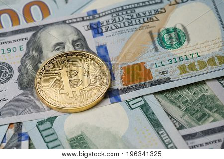 Picture of dollars with gold bitcoin