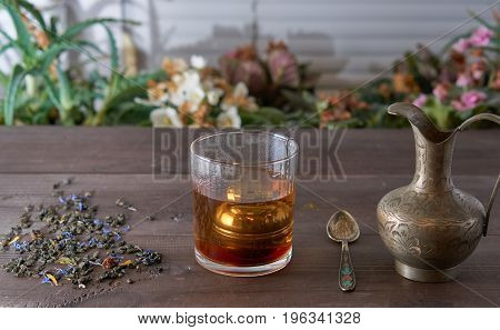 Cup Of Tea With Jug On Kitchen Desk