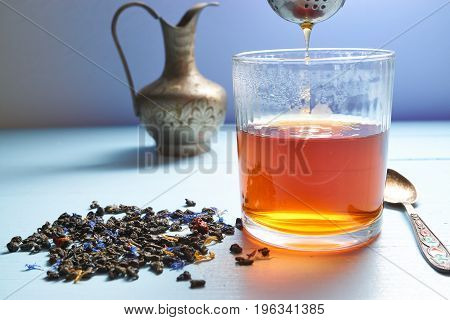 Glass Of Tea With Tea Strainer Out