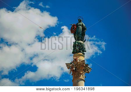 Detail of sculpture on the Column of the Immaculate Conception in Rome, the incredible city of the Ancient Era, known as